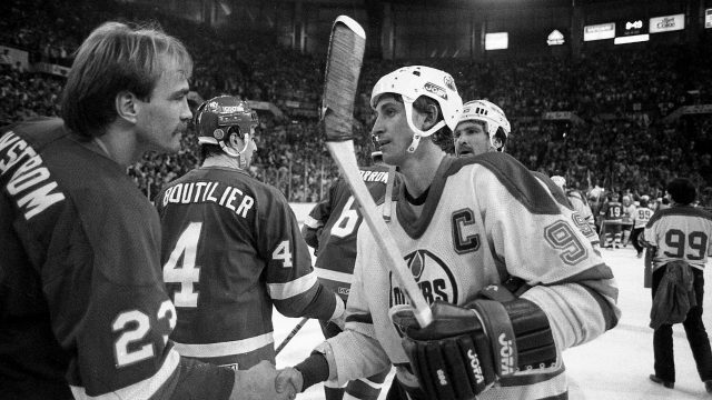 Bob-Nystrom-of-the-New-York-Islanders-congratulates-Wayne-Gretzky-and-the-Edmonton-Oilers-on-their-Stanley-Cup-victory,-Edmonton,-Alta.,-May-19,-1984.-The-Oilers-won-the-game-5-2.-(The-Canadian-Press)