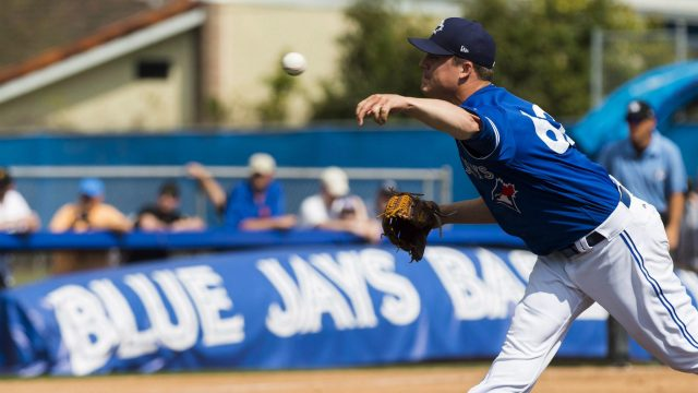 Toronto-Blue-Jays-relief-pitcher-Aaron-Loup-(62)-works-against-the-Pittsburgh-Pirates-during-fourth-inning-Grapefruit-baseball-spring-training-action-in-Dunedin,-Fla.,-on-Monday,-February-27,-2017.-(Nathan-Denette/CP)