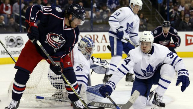 Columbus-Blue-Jackets-forward-Brandon-Saad,-left,-passes-the-puck-as-Toronto-Maple-Leafs-forward-Auston-Matthews-defends-during-the-second-period-of-an-NHL-hockey-game-in-Columbus,-Ohio,-Wednesday,-March-22,-2017.-(Paul-Vernon/AP)