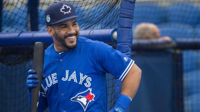 Toronto-Blue-Jays-second-baseman-Devon-Travis-smiles-while-taking-part-in-batting-practice-during-baseball-spring-training-in-Dunedin,-Fla.,-on-Thursday,-February-23,-2017.-(Nathan-Denette/CP)