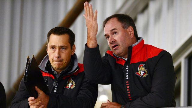 Ottawa-Senators-head-coach-Guy-Boucher,-left,-and-general-manager-Pierre-Dorion.-(Sean-Kilpatrick/CP)