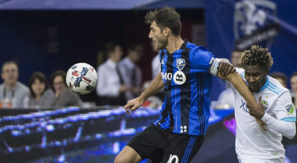 Montreal-Impact's-Ignacio-Piatti,-left,-holds-off-a-challenge-from-Seattle-Sounders-FC's-Oniel-Fisher-during-first-half-MLS-soccer-action-in-Montreal,-Saturday,-March-11,-2017.-(Graham-Hughes/CP)