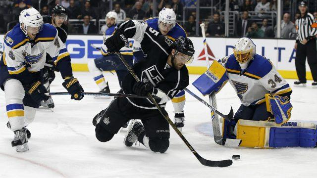 Los-Angeles-Kings-left-wing-Andy-Andreoff-(15)-shoots-at-St.-Louis-Blues-goalie-Jake-Allen-(34).-(Alex-Gallardo/AP)