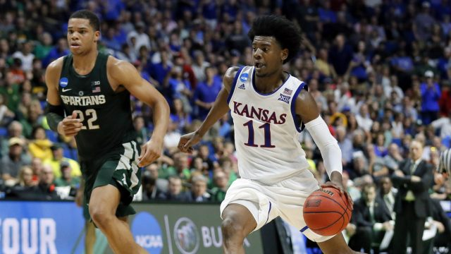 Kansas'-Josh-Jackson-(11)-advances-the-ball-to-the-basket-as-Michigan-State'-Miles-Bridges-(22)-gives-chase-in-the-second-half-of-a-second-round-game-in-the-men's-NCAA-college-basketball-tournament-in-Tulsa,-Okla.,-Sunday,-March-19,-2017.-(Tony-Gutierrez/AP)