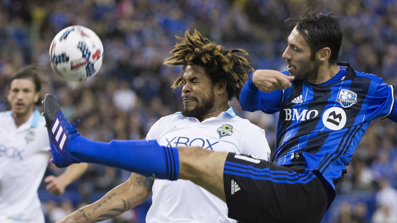 Montreal-Impact's-Matteo-Mancosu,-right,-challenges-Seattle-Sounders-FC's-Roman-Torres-during-first-half-MLS-soccer-action-in-Montreal,-Saturday,-March-11,-2017.-(Graham-Hughes/CP)