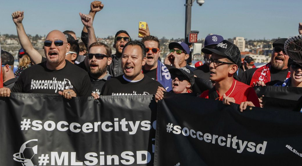 Soccer-fans-cheer-and-rally-before-a-Major-League-Soccer-press-conference-on-the-USS-Midway-Museum-in-San-Diego,-Calif.-(Eduardo-Contreras/The-San-Diego-Union-Tribune-via-AP)
