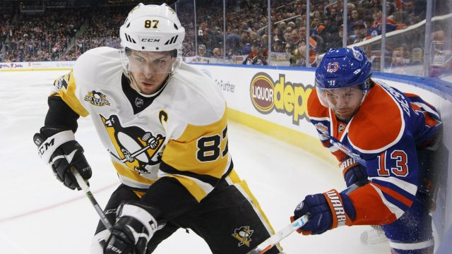 Pittsburgh-Penguins'-Sidney-Crosby-(87)-and-Edmonton-Oilers'-David-Desharnais-(13)-vie-for-the-puck-during-second-period-NHL-action-in-Edmonton,-Alta.,-on-Friday,-March-10,-2017.-(Jason-Franson/CP)