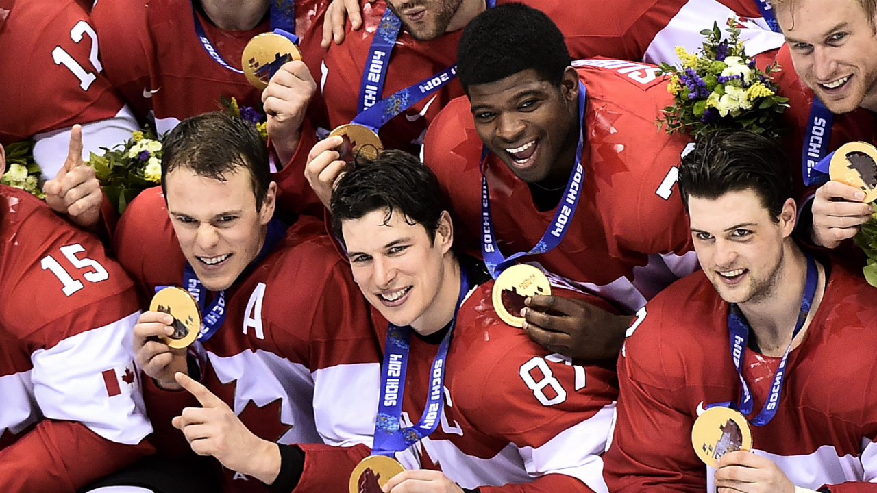 Team-Canada-captain-Sidney-Crosby,-centre,-poses-for-their-team-photo-after-defeating-Sweden-during-third-period-finals-hockey-action-at-the-2014-Sochi-Winter-Olympics-in-Sochi,-Russia-on-Sunday,-February-23,-2014.-(Nathan-Denette/CP)