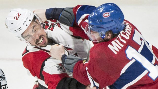 Montreal-Canadiens'-Torrey-Mitchell,-right,-fights-with-Ottawa-Senators'-Chris-Kelly-during-third-period-NHL-hockey-action-in-Montreal,-Sunday,-March-19,-2017.-(Graham-Hughes/CP)