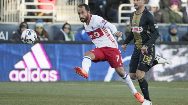 Toronto-FC's-Victor-Vazquez,-left,-kicks-the-ball-up-the-field-with-Philadelphia-Union's-Chris-Pontius,-right,-trailing-during-the-first-half-of-an-MLS-soccer-match,-Saturday,-March-11,-2017,-in-Chester,-Pa.-(Chris-Szagola/AP)