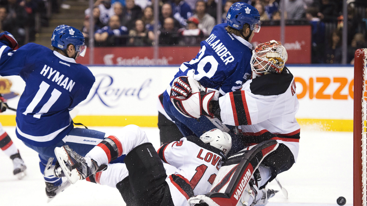 Toronto-Maple-Leafs-centre-William-Nylander-(29)-runs-into-New-Jersey-Devils-goalie-Keith-Kinkaid-(1)-as-Maple-Leafs-centre-Zach-Hyman-(11)-and-Devils-defenceman-Ben-Lovejoy-(12)-collide-during-second-period-NHL-action-in-Toronto-on-Thursday,-March-23,-2017.-(Frank-Gunn/CP)