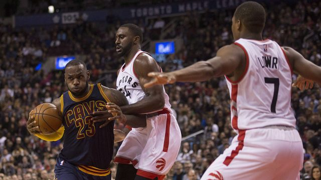 Cleveland-Cavaliers-forward-Lebron-James,-left,-drives-against-Toronto-Raptors-forward-Patrick-Patterson,-as-Raptors-guard-Kyle-Lowry-looks-on-during-second-half-NBA-basketball-action-in-Toronto-on-Friday,-October-28,-2016.-(Chris-Young/CP)
