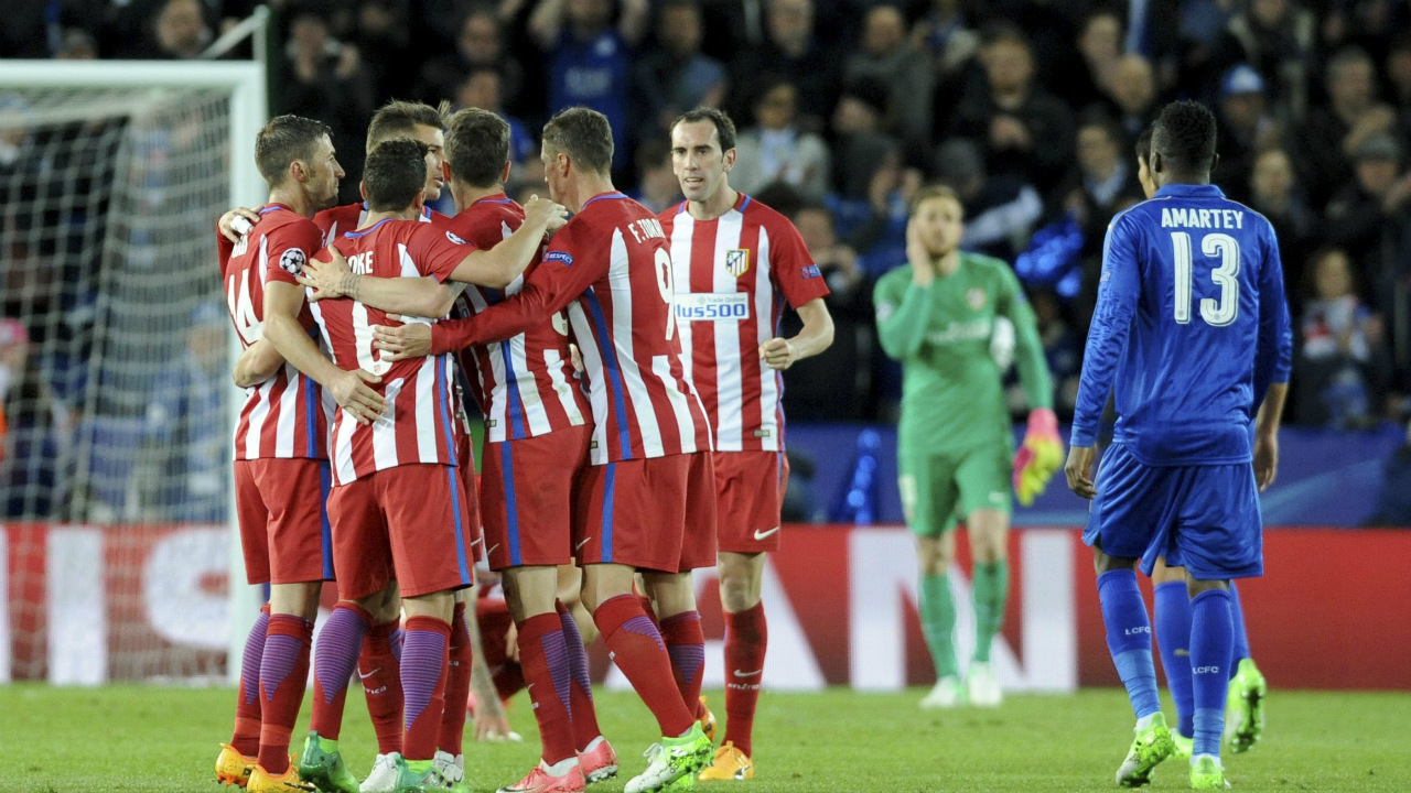 Atletico-Madrid-players-celebrate-after-the-Champions-League-quarter-final-second-leg-soccer-match-between-Leicester-City-and-Atletico-Madrid-at-King-Power-Stadium,-Leicester,-England,-Tuesday,-April-18,-2017.-(Rui-Vieira/AP)