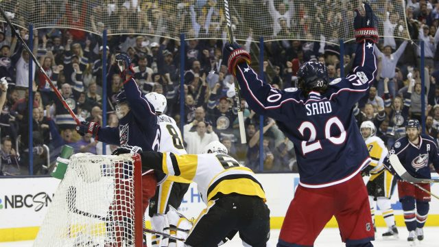 Columbus-Blue-Jackets'-Markus-Nutivaara,-left,-of-Finland,-and-Brandon-Saad-celebrate-a-goal-against-the-Pittsburgh-Penguins-during-the-second-period-of-Game-4-of-an-NHL-first-round-hockey-playoff-series-Tuesday,-April-18,-2017,-in-Columbus,-Ohio.-(Jay-LaPrete/AP)