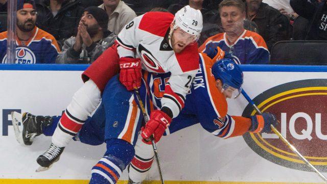 Carolina-Hurricanes'-Bryan-Bickell-(29)-battles-with-Edmonton-Oilers'-Tyler-Pitlick-(15)-during-first-period-NHL-hockey-action-in-Edmonton,-Alta.,-on-Tuesday-October-18,-2016.-(Amber-Bracken/AP)