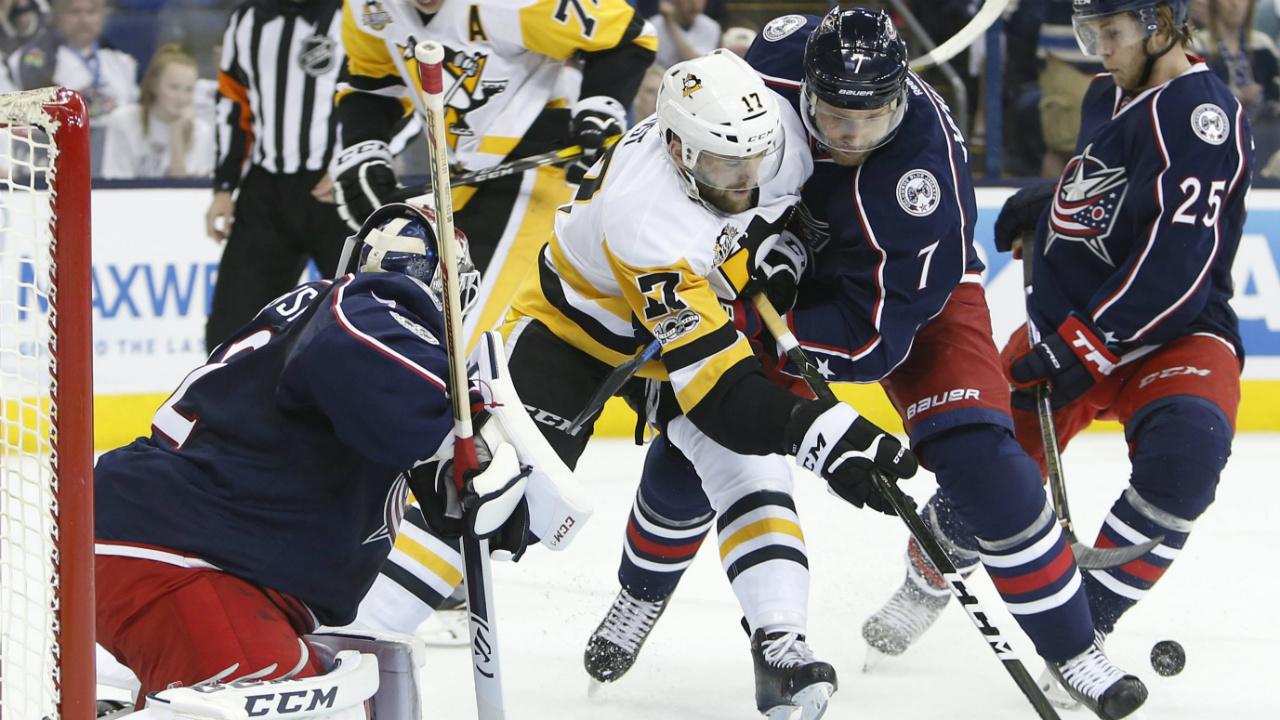 Columbus-Blue-Jackets'-Jack-Johnson,-right,-and-Pittsburgh-Penguins'-Bryan-Rust.-(Jay-LaPrete/AP)