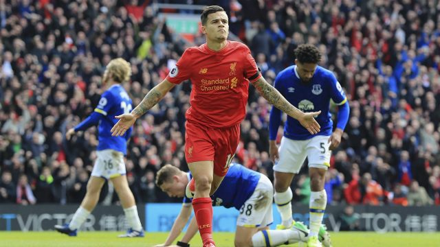 Liverpool's-Philippe-Coutinho-celebrates-scoring-his-side's-second-goal,-during-the-English-Premier-League-soccer-match-between-Liverpool-and-Everton,-at-Anfield,-in-Liverpool,-England,-Saturday-April-1,-2017.-(Peter-Byrne/PA-via-AP)