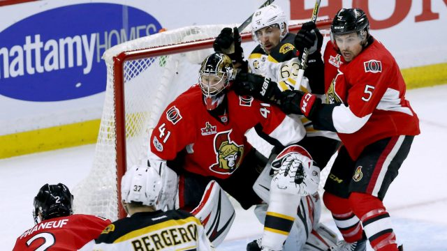Boston-Bruins-left-wing-Brad-Marchand-(63)-gets-stuck-between-Ottawa-Senators-goalie-Craig-Anderson-(41)-and-Ottawa-Senators-defenceman-Cody-Ceci-(5)-during-first-period-game-five-NHL-Stanley-Cup-playoff-action-in-Ottawa-on-Friday,-April-21,-2017.-(Fred-Chartrand/CP)