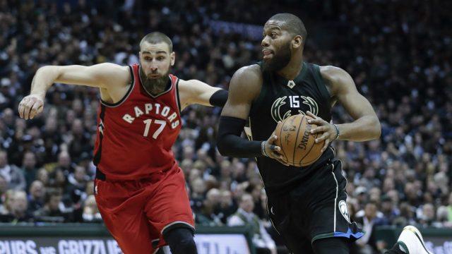 Milwaukee-Bucks'-Greg-Monroe-drives-past-Toronto-Raptors'-Jonas-Valanciunas-during-the-second-half-of-game-3-of-their-NBA-first-round-playoff-series-basketball-game-Thursday,-April-20,-2017,-in-Milwaukee.-(Morry-Gash/AP)