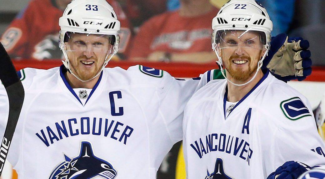 Vancouver-Canucks'-Henrik-Sedin,-left,-celebrates-with-his-brother-Daniel-Sedin.-(Jeff-McIntosh/CP)