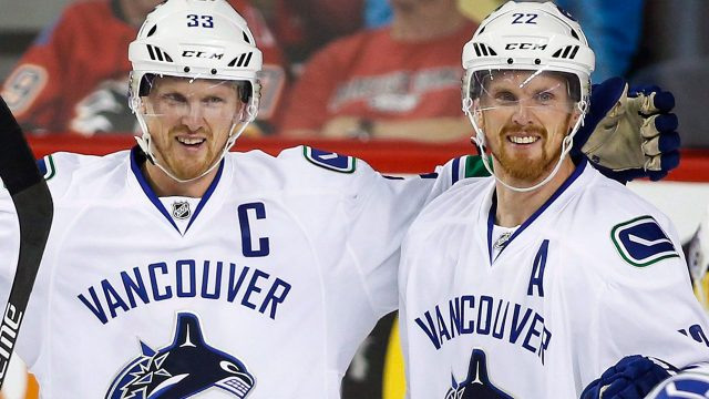 Vancouver-Canucks'-Henrik-Sedin,-left,-celebrates-with-his-brother-Daniel-Sedin.-(Jeff-McIntosh/CP)