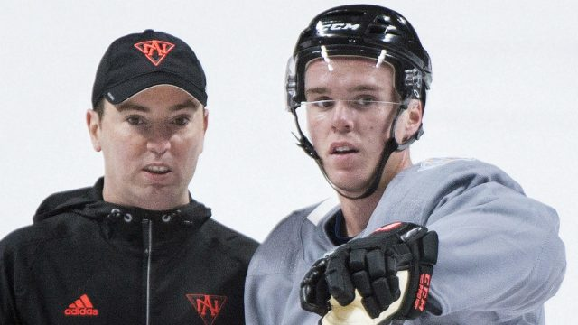 Team-North-America-player-Connor-McDavid,-right,-talks-with-assistant-coach-Jay-Woodcroft-during-training-camp-in-Montreal,-Monday,-September-5,-2016,-ahead-of-the-2016-World-Cup-of-Hockey-competition.-(Graham-Hughes/CP)