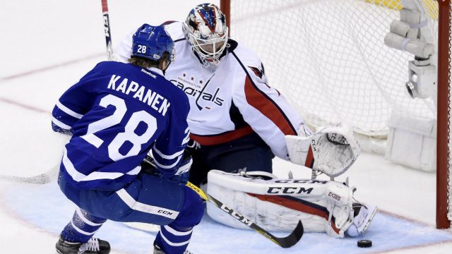 Washington-Capitals-goalie-Braden-Holtby-(70)-makes-a-save-on-Toronto-Maple-Leafs-right-wing-Kasperi-Kapanen-(28)-during-second-period-NHL-hockey-round-one-playoff-action-in-Toronto-on-Wednesday,-April-19,-2017.-(Nathan-Denette/CP)