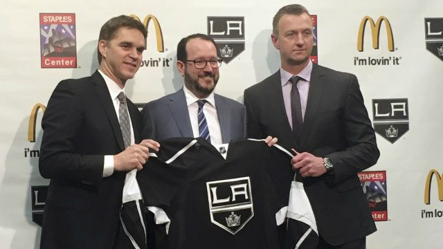 Los-Angeles-Kings-president-Luc-Robitaille,-left,-holds-up-a-team-jersey-with-Anschutz-Entertainment-Group-CEO-Dan-Beckerman,-middle,-and-Kings-general-manager-Rob-Blake-after-a-news-conference-Tuesday,-April-11,-2017,-in-Los-Angeles,-Calif.-Robitaille-and-Blake-were-promoted-by-the-Kings-after-the-firing-of-general-manager-Dean-Lombardi-and-coach-Darryl-Sutter.-(Greg-Beacham/AP)