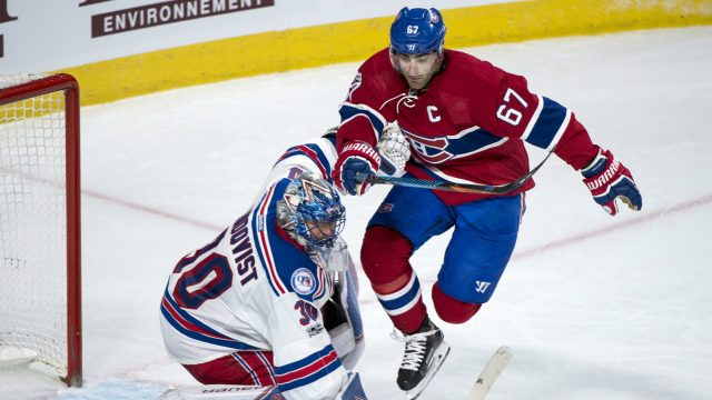 Montreal-Canadiens'-Max-Pacioretty-(67-)jumps-in-front-of-New-York-Rangers-goalie-Henrik-Lundqvist-during-the-second-period-of-Game-1-of-an-NHL-first-round-hockey-playoff-series-Wednesday,-April-12,-2017,-in-Montreal.-(Paul-Chiasson/The-Canadian-Press-via-AP)