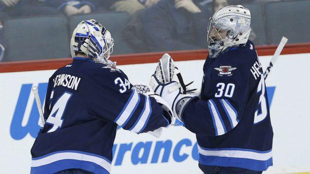 Winnipeg-Jets-goaltender-Michael-Hutchinson-(34)-replaces-goaltender-Connor-Hellebuyck.-(John-Woods/CP)