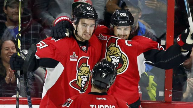 Ottawa-Senators'-Erik-Karlsson-(65)-celebrates-his-goal-with-teammates-Mark-Stone-(61)-and-Kyle-Turris-(7)-during-first-period-NHL-hockey-action-against-the-Detroit-Red-Wings,-in-Ottawa-on-Tuesday,-April-4,-2017.-(Fred-Chartrand/CP)