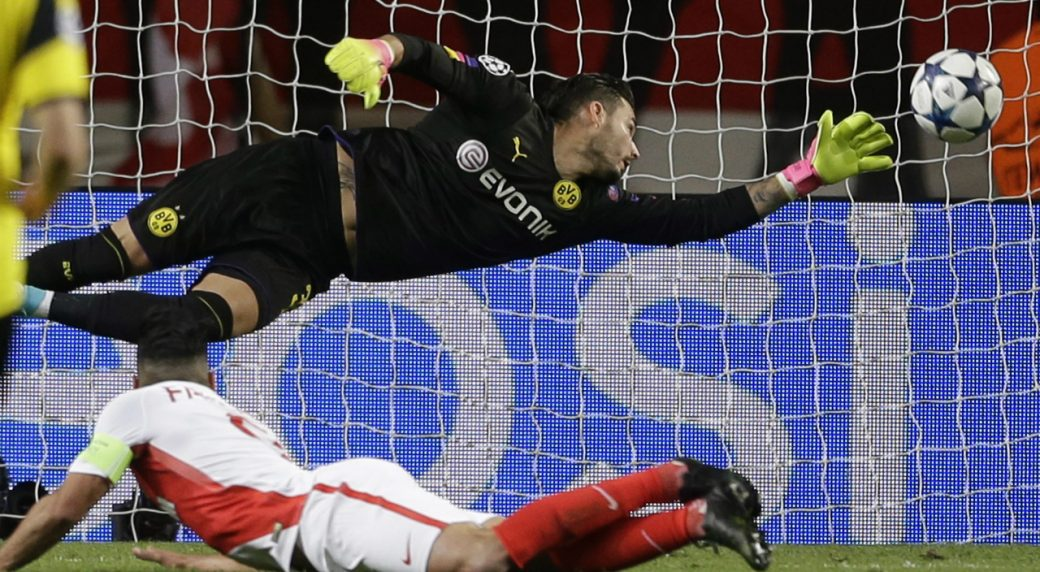 Monaco's-Radamel-Falcao,-below,-heads-the-ball-to-score-the-team's-second-goal-during-the-Champions-League-quarterfinal-second-leg-soccer-match-between-Monaco-and-Dortmund-at-the-Louis-II-stadium-in-Monaco,-Wednesday-April-19,-2017.-(Claude-Paris/AP)