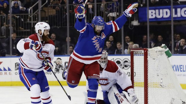New-York-Rangers-left-wing-Rick-Nash-(61)-celebrates-after-scoring-a-goal-as-Montreal-Canadiens'-Jordie-Benn,-left,-and-goalie-Carey-Price,-right,-watch-during-the-second-period-of-an-NHL-hockey-game-in-Game-4-of-an-NHL-hockey-first-round-playoff-series-Tuesday,-April-18,-2017,-in-New-York.-(Frank-Franklin-II/AP)