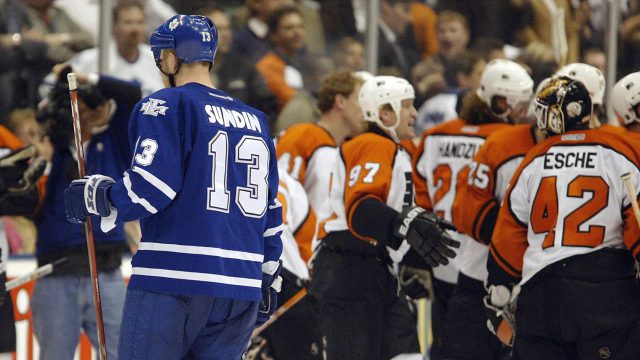 Toronto-Maple-Leafs-captain-Mats-Sundin-skates-by-as-members-of-the-Philadelphia-Flyers-celebrate-their-win-in-Game-6-of-the-2004-Stanley-Cup-playoffs