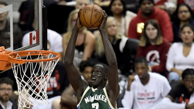 Milwaukee-Bucks-forward-Thon-Maker-(7)-dunks-the-ball-as-Toronto-Raptors-forward-Serge-Ibaka-(9)-tries-to-defend-during-second-half-NBA-playoff-basketball-action-in-Toronto-on-Tuesday,-April-18,-2017.-(Frank-Gunn/CP)
