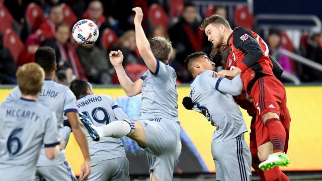 Toronto-FC-forward-Eriq-Zavaleta-(15)-sends-a-header-through-the-Chicago-Fire-defence-to-score-during-first-half-MLS-soccer-action-in-Toronto-on-Friday,-April-21,-2017.-(Frank-Gunn/CP)