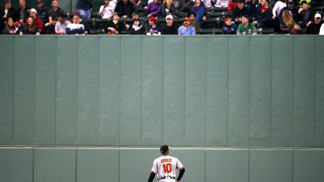 Baltimore-Orioles'-Adam-Jones-looks-up-at-fans-in-centre-field-during-the-third-inning-of-a-baseball-game-against-the-Boston-Red-Sox,-Tuesday,-May-2,-2017,-in-Boston.-(Michael-Dwyer/AP)