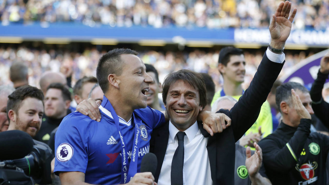 In-this-Sunday,-May-21,-2017-file-photo,-Chelsea-captain-John-Terry-celebrates-with-manager-Antonio-Conte-after-they-won-the-league,-following-the-English-Premier-League-soccer-match-between-Chelsea-and-Sunderland-at-Stamford-Bridge-stadium-in-London.-Antonio-Conte-acknowledges-it's-been-a-great-first-season-with-Chelsea,-the-new-English-Premier-League-champion.-It-could-have-a-sweeter-ending-on-Saturday,-May-27-if-they-can-take-the-FA-Cup,-too.-(Frank-Augstein,-file/AP)