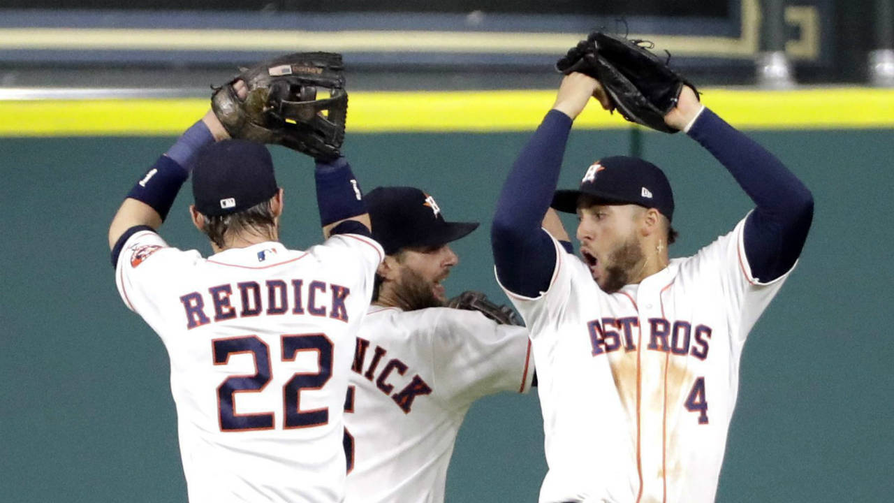 Houston-Astros-outfielders-Josh-Reddick-(22),-Jake-Marisnick,-centre,-and-George-Springer-(4)-celebrate-after-defeating-the-Los-Angeles-Angels-in-a-baseball-game,-Monday,-April-17,-2017,-in-Houston.-The-Astros-won-3-0.-(David-J.-Phillip/AP)