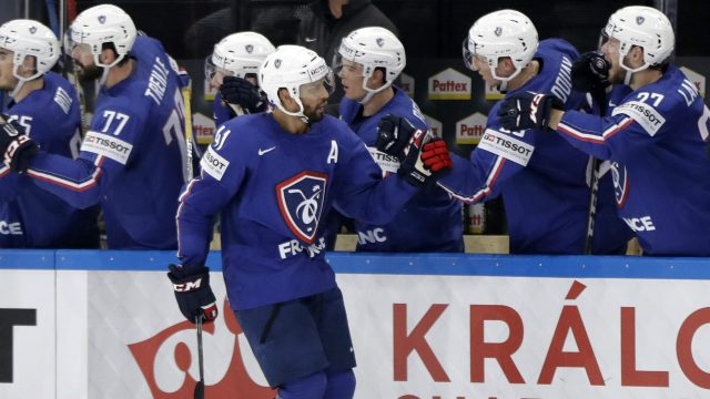 France's-Pierre-Edouard-Bellemare-celebrates-with-teammates-after-scoring-during-the-Ice-Hockey-World-Championships-group-B-match-between-France-and-Finland-in-the-AccorHotels-Arena-in-Paris,-France,-Sunday,-May-7,-2017.-(Petr-David-Josek/AP)
