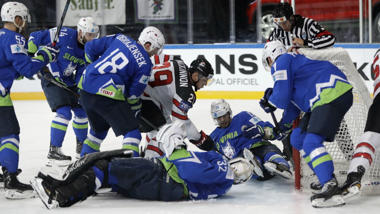 Canada's-Nate-Mackinnon,-centre-up,-scores-a-goal-past-Slovenia's-Gasper-Kroselj,-centere-down,-during-the-Ice-Hockey-World-Championships-group-B-match-between-France-and-Norway-in-the-AccorHotels-Arena-in-Paris,-France,-Sunday,-May-7,-2017.-(Petr-David-Josek/AP)