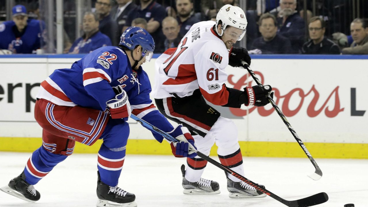 New-York-Rangers'-Nick-Holden-(22)-and-Ottawa-Senators'-Mark-Stone-(61)-reach-for-the-puck-during-the-first-period-of-Game-3-of-an-NHL-hockey-Stanley-Cup-second-round-playoff-series-Tuesday,-May-2,-2017,-in-New-York.-(Frank-Franklin-II/AP)