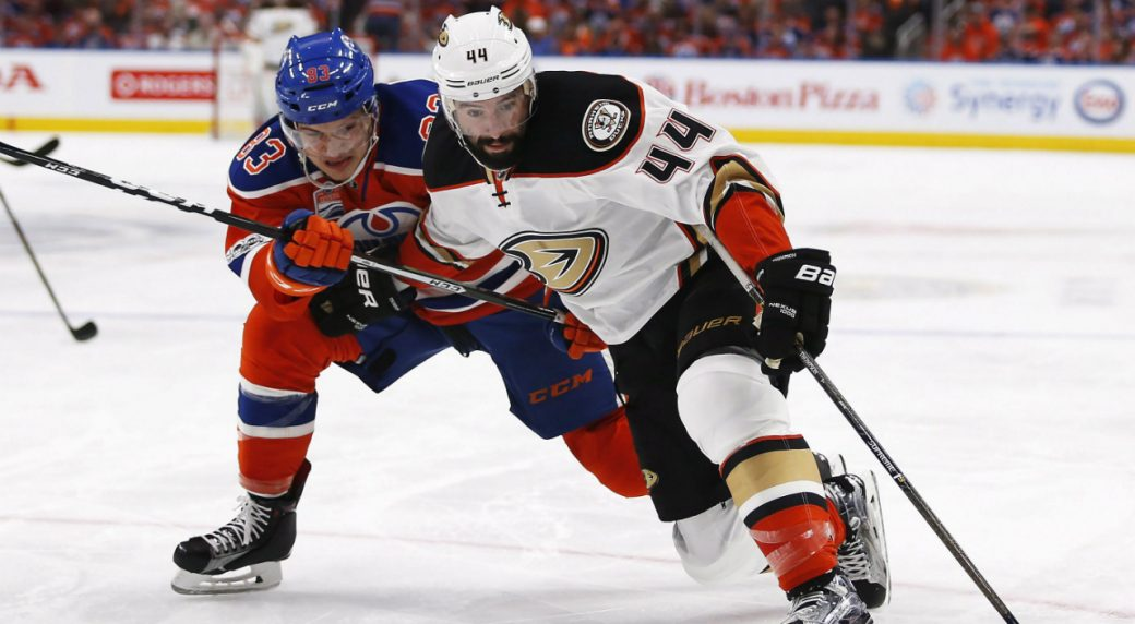 Anaheim-Ducks-centre-Nate-Thompson-(44)-protects-the-puck-from-Edmonton-Oilers-defenceman-Matthew-Benning-(83)-during-first-period-NHL-hockey-round-two-playoff-action-in-Edmonton-on-Wednesday,-May-3,-2017.-(Jeff-McIntosh/CP)