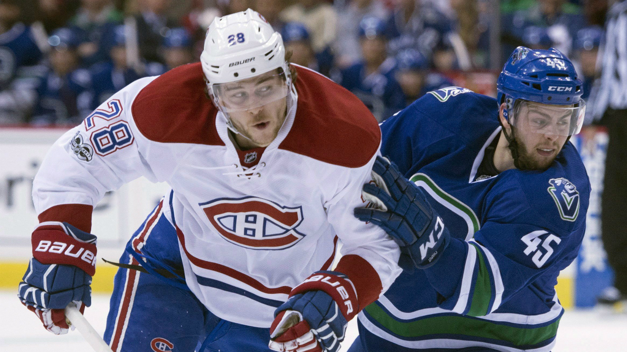 Vancouver-Canucks-centre-Michael-Chaput-(45)-fights-for-control-of-the-puck-with-Montreal-Canadiens-defenceman-Nathan-Beaulieu-(28)-during-first-period-NHL-action-in-Vancouver,-B.C.,-Tuesday,-March-7,-2017.-(Jonathan-Hayward/CP)