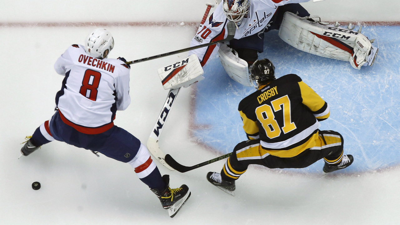 Pittsburgh-Penguins'-Sidney-Crosby-(87)-can't-get-a-shot-off-in-front-of-Washington-Capitals-goalie-Braden-Holtby-(70)-with-Alex-Ovechkin-(8)-defending-during-the-first-period-of-Game-3-in-an-NHL-Stanley-Cup-Eastern-Conference-semifinal-hockey-game-in-Pittsburgh,-Monday,-May-1,-2017.-Crosby-was-injured-on-the-play-and-did-not-return-to-the-game.-The-Capitals-won-in-overtime-3-2.-(Gene-J.-Puskar/AP)