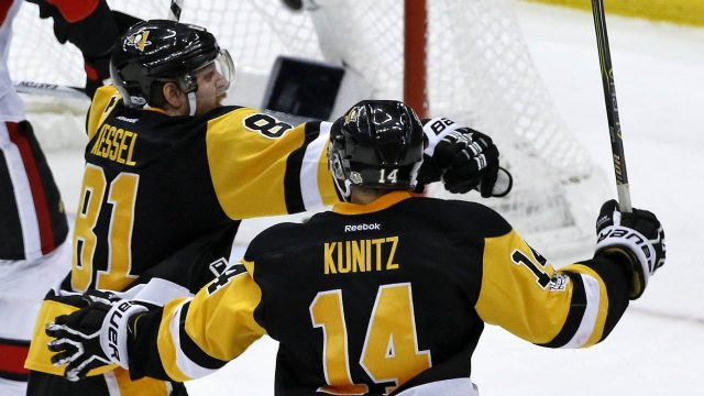 Pittsburgh-Penguins'-Phil-Kessel-(81)-celebrates-with-Chris-Kunitz-(14)-after-putting-a-shot-past-Ottawa-Senators-goalie-Craig-Anderson-for-the-game-winning-goal-during-the-third-period-of-Game-2-of-the-Eastern-Conference-final-in-the-NHL-Stanley-Cup-hockey-playoffs-in-Pittsburgh,-Tuesday,-May-16,-2017.-The-Penguins-won-1-0.-(Gene-J.-Puskar/AP)