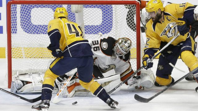 Anaheim-Ducks-goalie-John-Gibson-(36)-blocks-a-shot-as-Nashville-Predators-left-wing-Pontus-Aberg-(46),-of-Sweden,-and-centre-Mike-Fisher-(12)-watch-for-the-rebound-during-the-third-period-in-Game-3-of-the-Western-Conference-final-in-the-NHL-hockey-Stanley-Cup-playoffs-Tuesday,-May-16,-2017,-in-Nashville,-Tenn.-The-Predators-won-2-1-and-lead-the-series-2-1.-(Mark-Humphrey/AP)