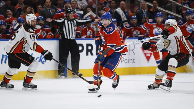 Anaheim-Ducks'-Ryan-Getzlaf,-left,-and-Patrick-Eaves,-right,-fail-to-stop-Edmonton-Oilers'-Ryan-Nugent-Hopkins-during-second-period-NHL-hockey-round-two-playoff-action-in-Edmonton,-Sunday,-April-30,-2017.(Jeff-McIntosh/CP)
