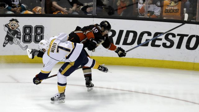Nashville-Predators'-Yannick-Weber-(7)-and-Anaheim-Ducks'-Corey-Perry-(10)-collide-as-they-battle-for-the-puck-during-the-first-period-of-Game-2-of-the-Western-Conference-final-in-the-NHL-hockey-Stanley-Cup-playoffs,-Sunday,-May-14,-2017,-in-Anaheim,-Calif.-(Chris-Carlson/AP)