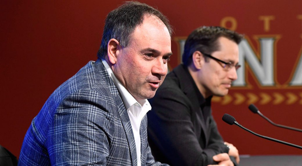 Ottawa-Senators-general-manager-Pierre-Dorion-answers-questions-from-media-in-June-2017-as-coach-Guy-Boucher-looks-on